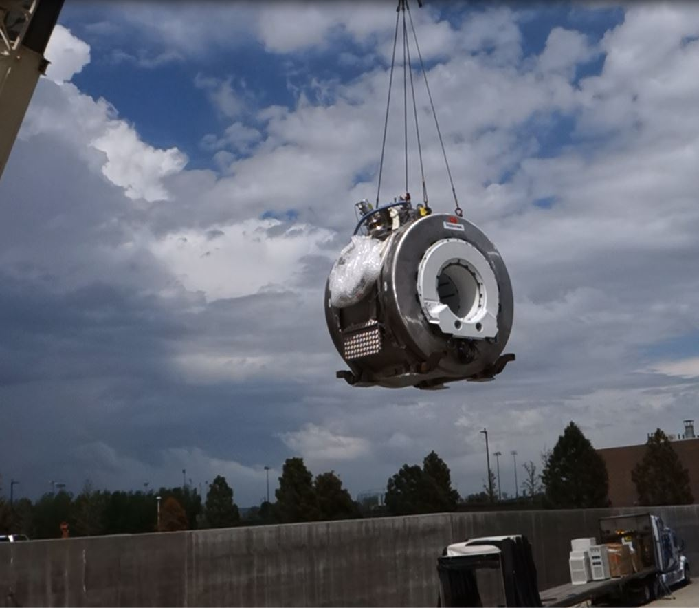 Crane carrying magnet to truck